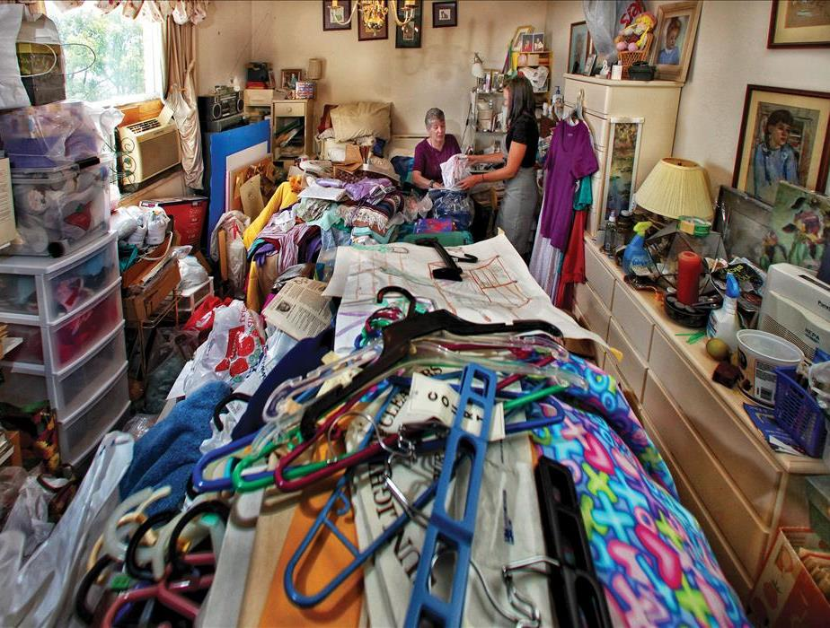 Hoarding household filled with piles of craft items.