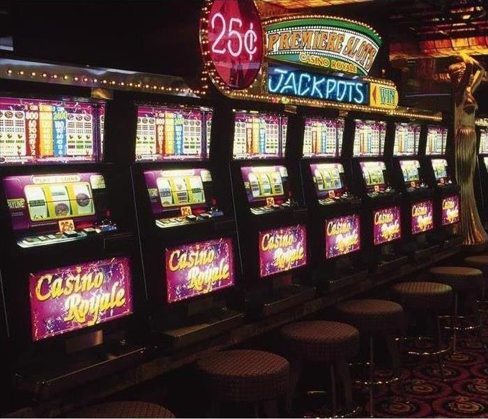 Electronic casino slot machines in a carpeted casino room