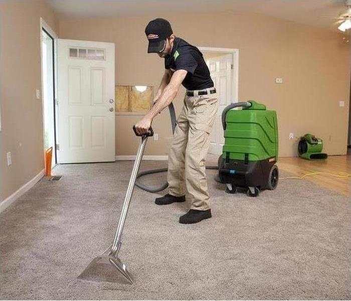 Technician cleaning carpets