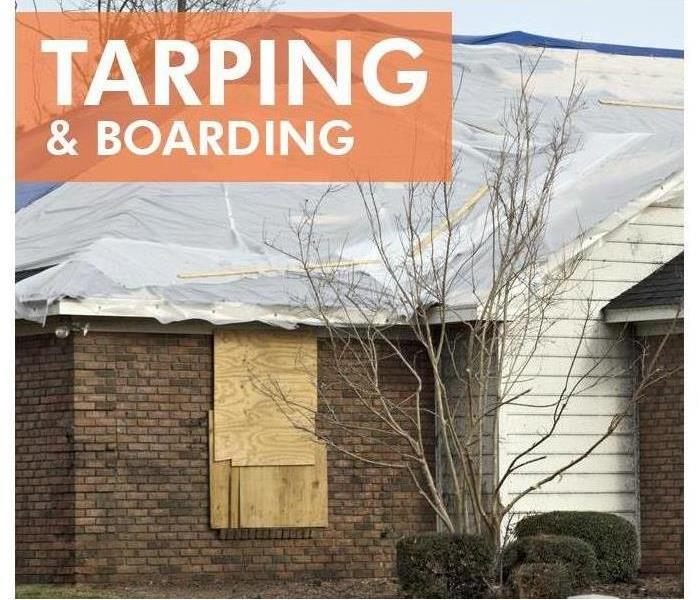 Tarping and boarding of a building